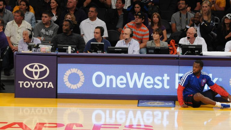 Calling hoops with Pistons' Rick Mahorn courtside in Los Angeles